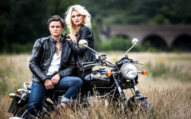 Couple in leather jackets on the Triumph Motorcycle